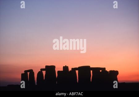 Sunset behind Stonehenge Nr Amesbury  Wiltshire England UK HOMER SYKES - Stock Photo
