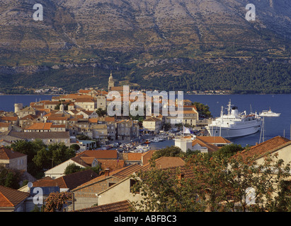 Croatia Dalmatian Coast Korcula overhead views of historic town and island looking north with ferryboat docking - Stock Photo