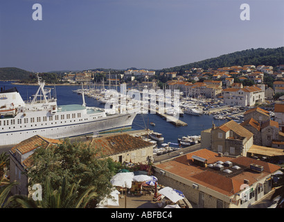 Croatia Dalmatian Coast Korcula overhead view of town looking south with car and passenger ferry at quayside - Stock Photo