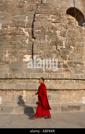 Monk walks around a stuppa in Sarnath, near Varanasi, India.  This is where  Buddha is reputed to have done his - Stock Photo