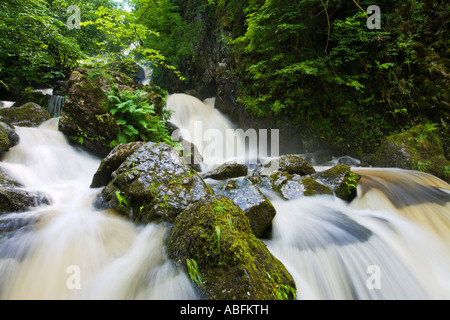 Lodore Falls In Full Spate High Waterfall After Heavy Rainstorm Cascading Over Rocks, Derwent Water Keswick Lake - Stock Photo
