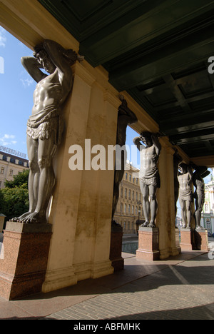 Atlantes statues in portico outside New Hermitage, St Petersburg - Stock Photo