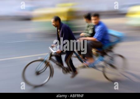 India, Haryana, Delhi Cycle rickshaw blurred movement - Stock Photo