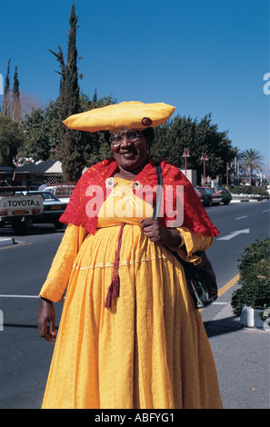Herero lady in traditional dress on Independence Avenue Windhoek Namibia south west Africa - Stock Photo
