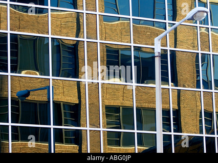 A street light is reflected in the windows of an office building in Lincoln, Nebraska. - Stock Photo