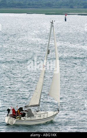 sailing yacht cruising along close hauled on port tack - Stock Photo