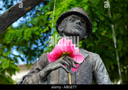 Karl Valentin monument (fountain) with flower at the Viktualienmarkt, Munich, Bavaria, Germany - Stock Photo
