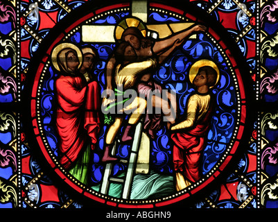Detail from stained glass window showing Jesus being removed from the cross, in Notre Dame Cathedral Bayeux Normandy - Stock Photo