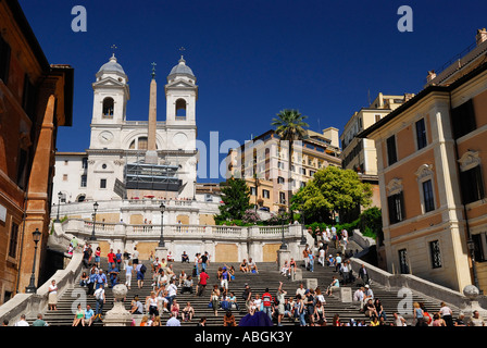 Tourists on the Spanish steps from Piazza di Spagna to Piazza Trinita dei Monti Rome Italy - Stock Photo