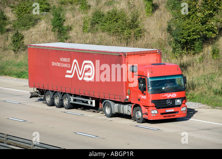 M25 motorway foreign continental left hand drive Norbert Dentressangle Mercedes articulated trailer & lorry - Stock Photo