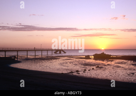 Sunset over bay of Maputo over pier on Inhaca Island near Maputo, Mozambique - Stock Photo