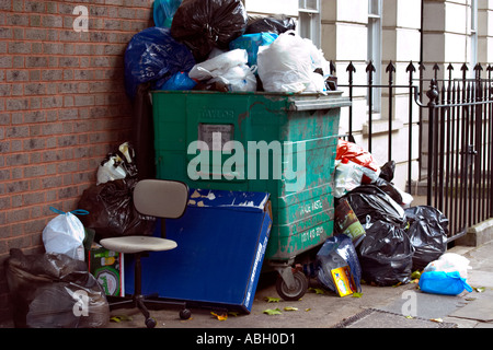 rubbish litter bin waste smelly smell bad overloaded packaging environment rubbish litter bins - Stock Photo