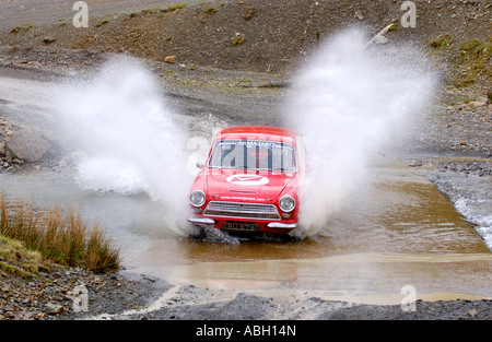 Rally enthusiasts with Vintage Ford Lotus Cortina rally car at the Sweet Lamb Rally Complex Llangurig Powys Mid - Stock Photo