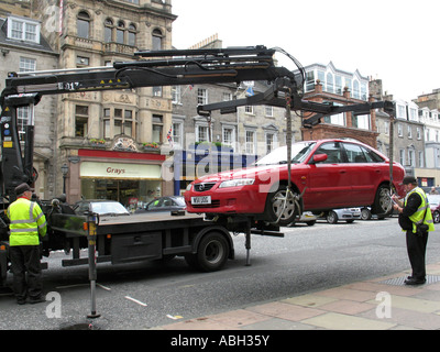 Illegally parked car being uplifted on George Street . - Stock Photo