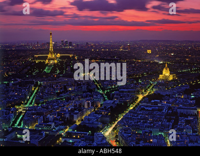 Overview of Paris at dusk with Hotel Invalides Eiffel Tower and Arc de Triomphe - Stock Photo