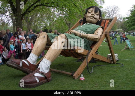 The Little Girl asleep in deckchair. The Sultan's Elephant street theatre by Royal de Luxe. St James's Park, London, - Stock Photo