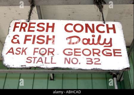 Sign selling fresh conch seafood Potters Cay on New Providence Island in Bahamas - Stock Photo