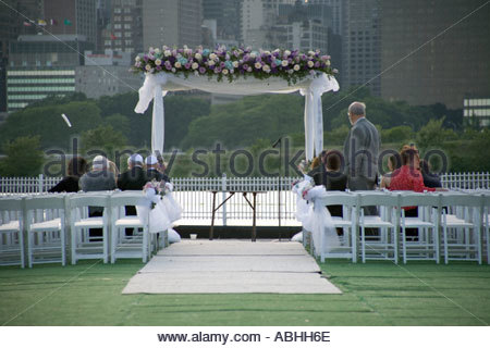 family and parents waiting at a religious mixed wedding ceremony - Stock Photo