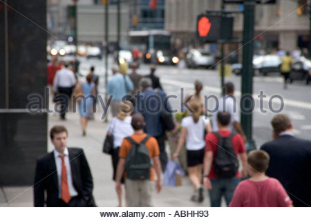 out of focus view of pedestrians on a New York street - Stock Photo