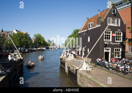 Cafe de Slujswacht a typical brown cafe at canal Oude Schans Amsterdam Holland Netherlands - Stock Photo