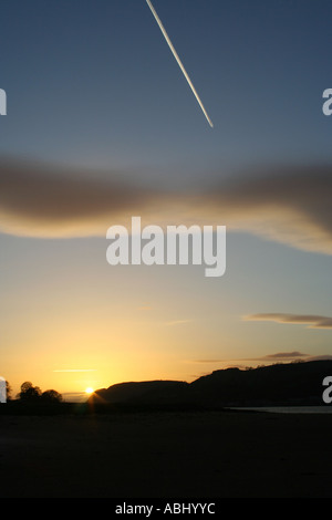 Sunset with jet contrail, looking down the River Clyde south of the Erskine Bridge, Scotland, UK. - Stock Photo