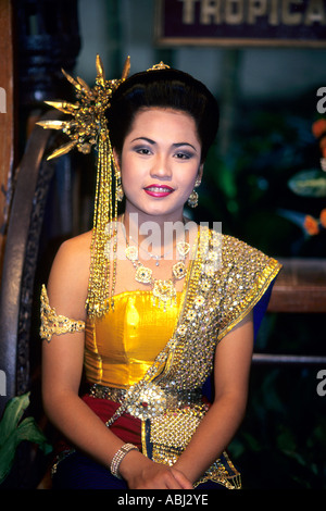 Lady in traditional Thai dress, Nong Nooch, Thailand - Stock Photo