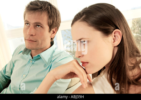 Sulking couple in living-room - Stock Photo