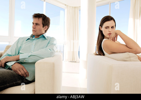 Couple sulking in living-room - Stock Photo