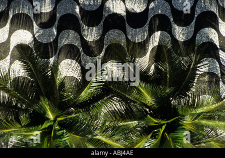 Rio de Janeiro, Brazil. Typical black and white mosaic pavement seen from above with palm trees on Copacabana beach - Stock Photo