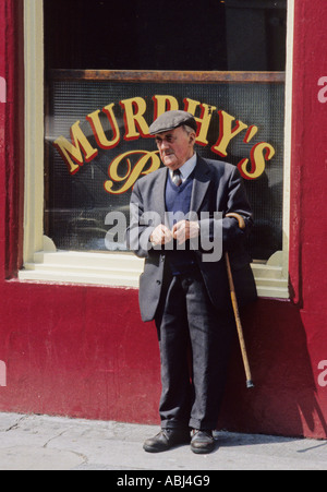 Old man stands outside a bar, Galway City, County Galway, Republic of Ireland - Stock Photo