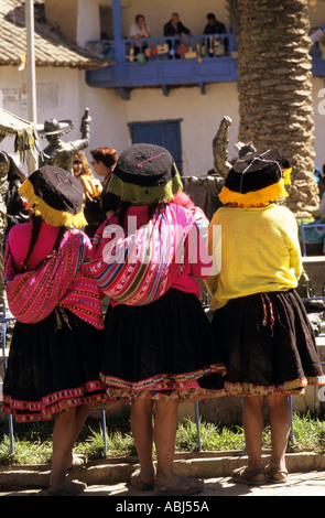 Paucartambo, Peru. Three women wearing traditional clothes and hats from the back. - Stock Photo