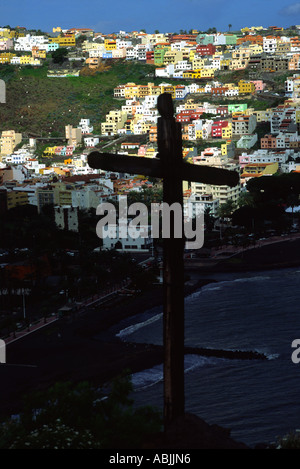 A wooden cross stands on a hill overlooking San Sebastian, La Gomera, Canary Islands - Stock Photo