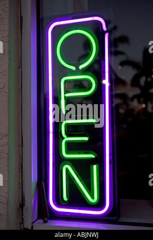 Neon Open sign in window - Stock Photo