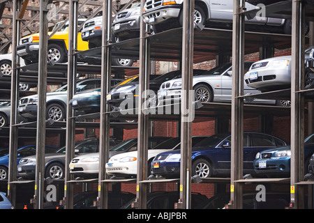 Cars stacked in urban parking lot - Stock Photo