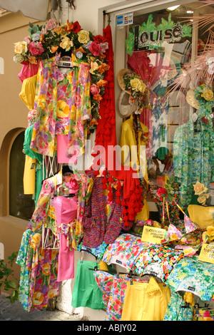 Colourful display at outdoor ladies fashion shop in Positano Amalfi Coast Italy - Stock Photo
