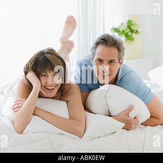 Couple laying on bed - Stock Photo