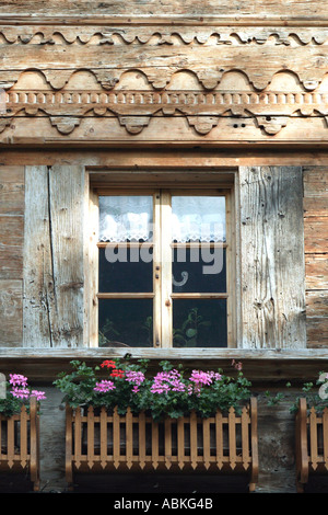 Typical window display of traditional Swiss Alpine chalet Chateau d Oex village Pays d Enhaut Bernese Oberland Switzerland - Stock Photo