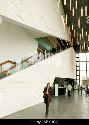 A woman walks through the imposing foyer of MIMA the Middlesbrough Institute of Modern Art - Stock Photo