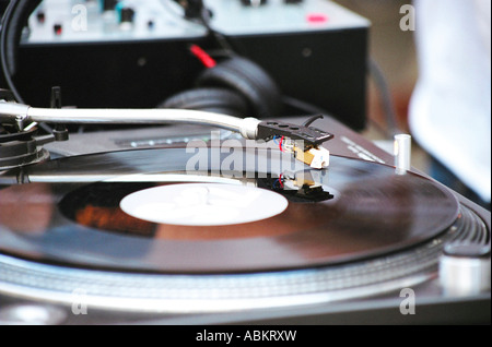 DJs Record Deck with record playing - Stock Photo