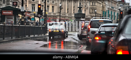 ['JUL 7'  An interesting car ^number-plate] - Wet day in London - Stock Photo