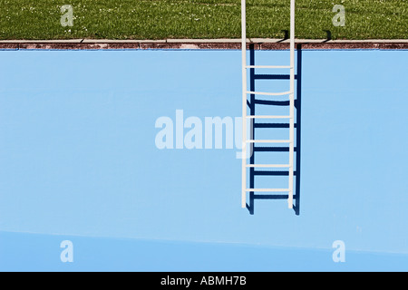 Ladder At Wall Of Empty Swimming Pool - Stock Photo