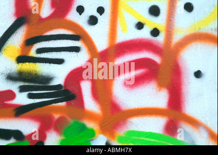 Graffiti abstract sprayed on the side of a metal storage container - Stock Photo