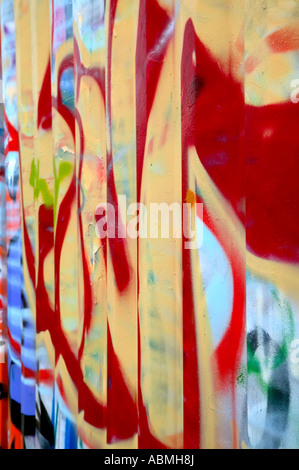 Graffiti sprayed on the side of a storage container - Stock Photo