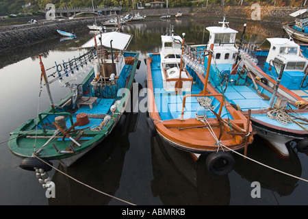 Fishing boats equiped with powerful lights to attract squid at night Seogwipo harbor Jeju Do South Korea - Stock Photo