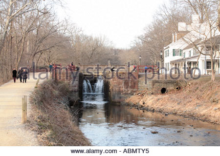 Water cascades from the lock at Great Falls Tavern on the C&O Canal - Stock Photo