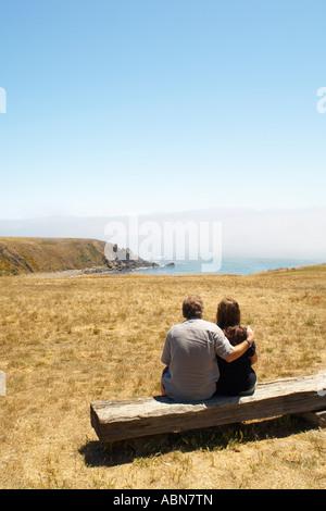 Couple on Bench, Mendocino, California, USA - Stock Photo