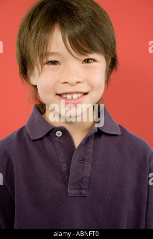 Portrait of Asian boy smiling - Stock Photo