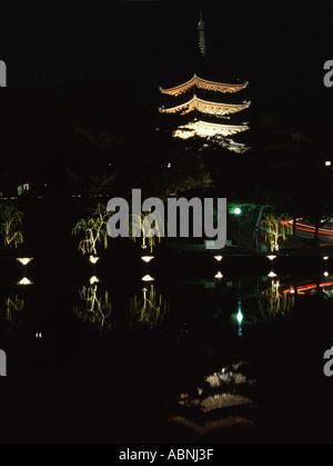 Kofuku ji temple is reflected in Sarusawa Pond - Stock Photo