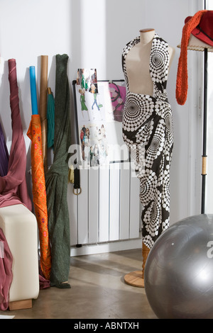 Fabric draped over clothes-making dummy - Stock Photo
