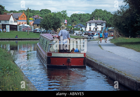 LLANGOLLEN DENBIGHSHIRE NORTH WALES UK Canal boat passing into Trevor Basin where Llangollen meets Shropshire Union - Stock Photo